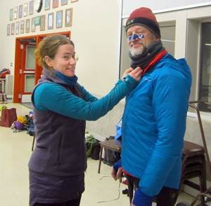 Yvonne Leutwyler helps bundle Clark Fair for the cold, including tape across the nose and cheeks to prepare against frostbite.