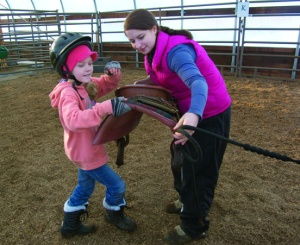 Students learn all the basics of horsemanship, from riding to the not-so-fun stuff, like saddling.