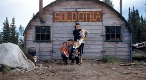 Photo courtesy of the Soldotna Historical Society. Paul Nestor and his family pose for a photo in 1968 in front of the Quonset hut that once housed Nestor's business in Soldotna.