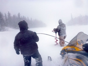 A crew from Fish and Game, U.S. Fish and Wildlife Service Kenai Fisheries Office and the Kenai National Refuge cut holes in the ice covering Daniels Lake last week to test for the presence of elodea and map how far it has spread.