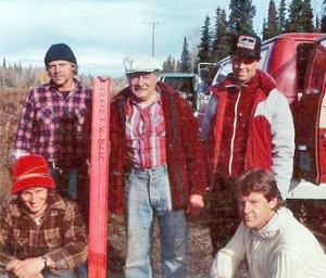 Photos courtesy of Brent Johnson. Henning Johnson (in white hat, center) poses with a survey crew in the middle 1980s. At left, standing, is Henning's son, Jerry. His other son, Brent, is kneeling in front of Jerry. At right are Scott McLane (standing) and Sam McLane.