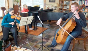 Photo by Jenny Neyman, Redoubt Reporter. Emily Grossman, violin, Maria Allison, piano and Kevin Charlestream, cello, rehearse in Kenai on Saturday for an upcoming Musica Borealis performance.