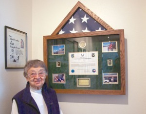 Mary Quesnel, 93, of Kenai, received an American flag that was flown on Wake Island in the Pacific, in honor of her service during World War II.