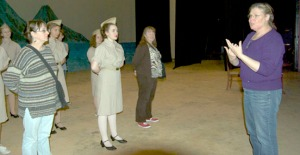 "The nurses of ""South Pacific"" stand at attention for direction from Terri Zopf-Schoessler, at right."
