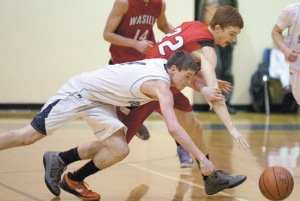 Soldotna Stars' Preston Penrod and Wasilla's Isaiah Dawkins scramble after the ball during the weekend's quarterfinal match at the 2013 Northern Lights Conference Tournament in Soldotna.