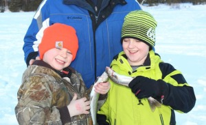 Photo courtesy of Christine Cunningham.Patrick and William show off part of their ice-fishing catch.