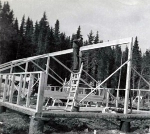 Photo by Roxy Skobelska, via Alaska Digital Archives. In 1950, shortly after both he and Roxy had moved to Bear Cove, Harold Pomeroy was helping to construct a pair of greenhouses for Roxy's vegetable-growing operation.