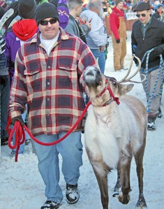Photos by Clark Fair, Redoubt Reporter. A handler corrals a reindeer for another trip up the street.