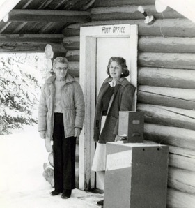 Nina Robinson and Sterling postmaster Gloria McNutt pose in front of the old Sterling post office in 1976.