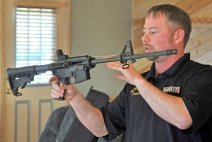 Photos by Joseph Robertia, Redoubt Reporter. Travis Wright demonstrates how to disassemble and properly clean an AR-15-style rifle during a basic AR maintenance class held Thursday at the Snowshoe Gun Club in Kenai. It was one of many planned for the coming year, as the gun club has recently built an indoor facility to host educational functions.