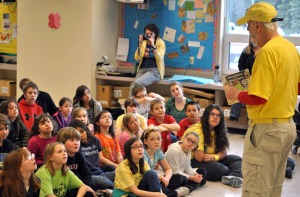 "Photos by Joseph Robertia, Redoubt Reporter. Mike Thaler, author of the ""Black Lagoon"" youth book series, visits with students at Tustumena Elementary School in Kasilof last week. He also visited Kaleidoscope School of Arts and Science in Kenai and Redoubt Elementary School in Soldotna."