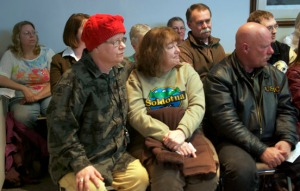Terri Burdick, center, is comforted by supporters during the April 10 council meeting.