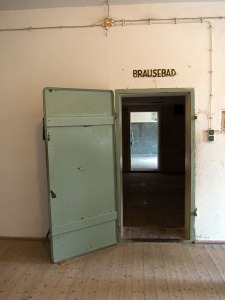 "A door to the gas chamber at Dachau, falsely labeled as ""bath,"" so as not to panic prisoners being sent to their deaths."