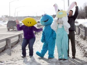 Marcus Mueller, president of the Soldotna Rotary Club, clowns around with the Cookie Monster, Easter Bunny and a Lemonhead mascot on the Kenai River bridge. The characters were to demonstrate to motorists that the activity on the bridge was nothing to be alarmed about.