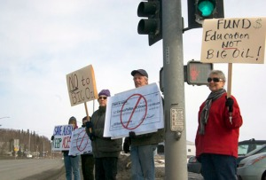 "Photo by Jenny Neyman, Redoubt Reporter. From right, Patricia McClain, of Soldotna, Bill Larned, of Soldotna, Gail Duncan, of Soldotna, Donna Rea, of Kasilof, and Sue Larned, of Soldotna, hold signs at the ""Y"" intersection in Soldotna on Saturday afternoon during a rally to raise awareness of pending legislation."