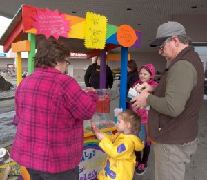 Customers consider their many options at Nala Johnson's Rainbow Lemon Splash stand.