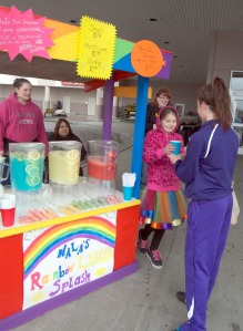 Photos by Jenny Neyman, Redoubt Reporter. Nala Johnson serves a customer at her Lemonade Day stand at Fred Meyer on Saturday.