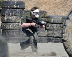 Photos by Joseph Robertia, Redoubt Reporter. A skull-masked player advances down the field while taking heavy fire at the Pointblank paintball course May 25. The new course is located off Kalifornsky Beach Road.