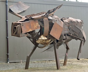 Photo by Joseph Robertia, Redoubt Reporter. A scrap metal moose standing in front of Kenai Peninsula College's Kenai River Campus was built by Paul Tornow. It is a large example of salvage art, but smaller pieces are expected for the upcoming ReGroup Salvage Art Exhibit.