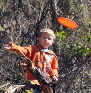 Photos by Joseph Robertia, Redoubt Reporter. Mikhail Parrish, 5, plays in the Salmon Toss Disc Golf Tournament on Saturday while on vacation from Germany. The event was hosted by River City Rotaract and held at the 19-hole course at Tsalteshi Trails behind Skyview High School.