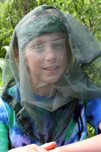 Photo by Clark Fair, Redoubt Reporter. Headnets hinder one's vision and can be uncomfortable, but they are effective at keeping biting and stinging insects away from the face and neck.