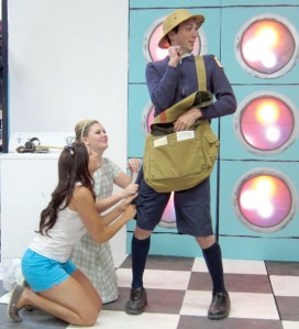 Dimick advises Cindy (Alyeska Krull) on how to harass Mr. Postman (Spencer McAuliffe).