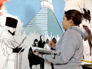 Shana Butler works on a section depicting the area's Russian Orthodox history.