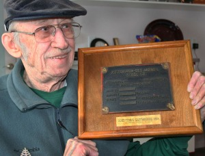 Photo by Clark Fair, Redoubt Reporter. Clayton Brockel displays a plaque pulled from a water tower that collapsed at Wildwood Army Station in the 1964 Good Friday earthquake. Brockel has been a fixture of education on the Kenai Peninsula, having been the founding director of Kenai Peninsula College. He died July 10, at age 86.