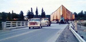 Photo courtesy of Soldotna United Methodist Church archives. The Tustumena Church of Christ the Victor is hauled from Kasilof across the Kenai River bridge to its new location in Soldotna, and its new name, Soldotna Methodist Church, in 1968.