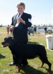 Cory Barett proudly displays his ribbon with his Rottweiler, Gabby.