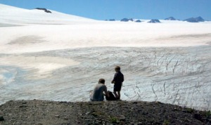 Hikers survey the Harding Ice Field above Exit Glacier in Seward on July 22. Scientists are measuring the thickness of the ice in order to someday determine its volume, to help predict the future of the ice field and its many glaciers.