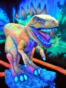 Photos by Joseph Robertia, Redoubt Reporter. A Tyrannosaurus Rex lights up the décor in a new black light mini-golf course set to open July 31 as part of Jumpin' Junction's expansion on Kalifornsky Beach Road.