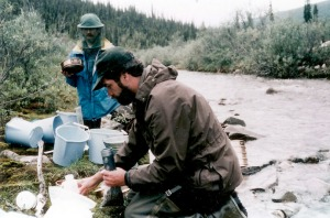 North was EPA's mining inspector in Alaska for eight years. Here he collects water samples for testing.