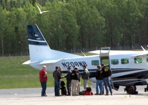 NTSB investigators arrive at the Soldotna airport on Monday. They will spend five to eight days on-site, then pack up evidence and continue their investigation in Washington, D.C. A preliminary report is expected within 30 days, though investigation could continue for a year.