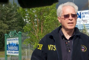 NTSB Board Member Earl Weener gives a press briefing at the Soldotna Airport early Monday evening.
