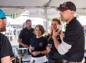 Photo courtesy of Joe Kashi. Servers discuss their wares with Kenai Beer Festival  attendees.