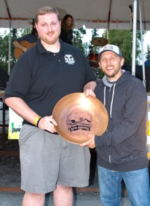 Photo courtesy of Elaine Howell. Kassik's brewer Drew Walker accepts the People's Choice Award for best beer from Matt Pyhala with Soldotna Rotary.