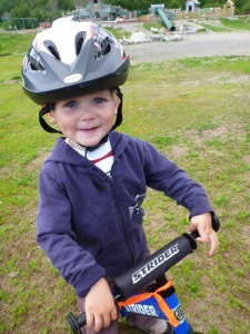 Photos courtesy of Bryan and Lacy Ledahl. 2-year-old Iver Ledahl motors is all smiles when he gets to ride his balance bike.