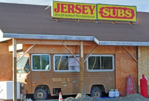 Photo by Joseph Robertia, Redoubt Reporter. The bus at the Kasilof location of Jersey Subs is how the business began, but this week the bus will be removed as a larger more modern restaurant has been built to take its place.