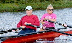 Judy Demers and Terri Zopf-Schoessler row in a double boat on Mackey Lake on Saturday. Demers will row in several events in Italy.