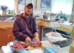 Photo courtesy of James Banks. James Banks, of Kasilof, makes burger out of a moose he shot on the opening day of moose season, within miles and minutes of leaving the house.