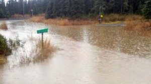 Karluk Avenue is covered in standing water Monday.