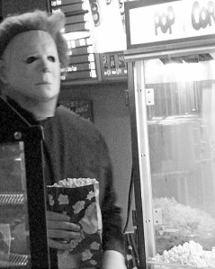 "Orca's staff got into the festivities of dressing up for midnight shows. Mason Galbraith serves popcorn and other goodies while dressed as Michael Meyers from the ""Halloween"" horror series."