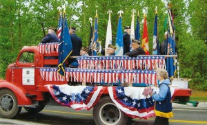 Reeder on a veterans float in a Soldotna parade.
