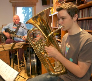 "Mike Morgan, left, and Logan Boyle rehearse Spirit Daddies songs as part of the Baked Alaskans and their Spawn — the ""spawn"" being the kids of Matt Boyle (Logan), and Kurt Eriksson (Austin and Anton)."