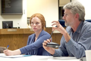 Robert Ruffner, executive director of the Kenai Watershed Forum, voices his concerns about the bill to Fish and Game Commissioner Cora Campbell, at left, and Fogels.