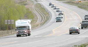 File photo. An RV leads a string of traffic into Soldotna on the Sterling Highway over Memorial Day weekend. Traffic on the stretch of highway from the Moose River to Soldotna sees a sharp increase during fishing season, contributing to the road's danger of traffic collisions. The Alaska Department of Transportation and Public Facilities is considering options to improve safety along that section of road.