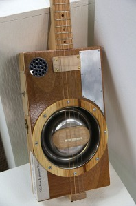 Gale incorporated enhancements to increase the resonance of the cigar box in this guitar.