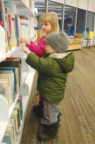 Amara and Mark Ransom browse through books in the vastly expanded kids section at the newly remodeled Soldotna Public Library in December. The expansion has allowed the library to stock more books and to offer more programs for the community.