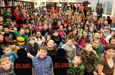 Redoubt Reporter illustration, photo courtesy of Kenai Peninsula Borough School District. Nikiski North Star Elementary School students gather in the library to greet Sen. Lisa Murkowski on a recent school visit. The Kenai Peninsula Borough School District is facing a $4.5 million deficit at this point in its budget process, causing the school board and administration to be doubly careful in estimating costs — such as deciding school staffing levels — and revenues, which primarily come as a per-pupil allocation from the state. Declining enrollment means declining funding, which necessitates a decline in expenditures.